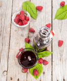Raspberry Sirup in a glass. (with fresh fruits Stock Photo