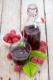 Raspberry Sirup in a glass. (with fresh fruits Stock Image