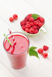 Raspberry smoothie and berries. On wooden table Royalty Free Stock Photo