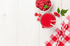 Raspberry smoothie and berries. On wooden table. Top view with copy space Stock Photo