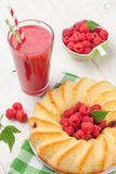 Raspberry smoothie, cake and berries. On wooden table Royalty Free Stock Photos