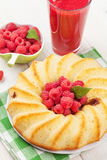 Raspberry smoothie, cake and berries. On wooden table Stock Photos