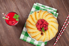 Raspberry smoothie, cake and berries. On wooden table. Top view Royalty Free Stock Photography