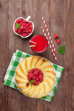 Raspberry smoothie, cake and berries. On wooden table. Top view Royalty Free Stock Photo