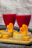 Raspberry smoothie with carved pumpkin hearts Royalty Free Stock Images