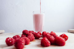 Raspberry smoothie fresh blended on summer wood table Royalty Free Stock Photo