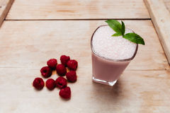 Raspberry smoothie fresh blended on summer wood table Royalty Free Stock Photography