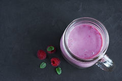Raspberry smoothie in a glass jar. With a fresh berries Stock Photos