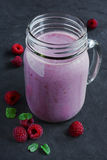 Raspberry smoothie in a glass jar. With a fresh berries Royalty Free Stock Images