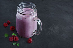 Raspberry smoothie in a glass jar. With a fresh berries Stock Photo