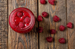 Raspberry smoothie in glass jar on wood table. Top view Stock Photos