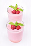 Raspberry smoothie in glass. On white background Royalty Free Stock Photo