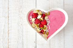 Free Raspberry Smoothie In A Heart Bowl With Superfoods Over White Wood. Stock Photography - 107760152