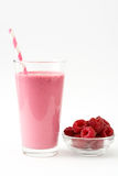 Raspberry smoothie isolated on white background. Raspberry smoothie in glass isolated on white background Royalty Free Stock Photography