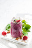 Raspberry smoothie with oatmeal, chocolate and mint, vertical. Closeup Stock Photography