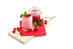 Raspberry smoothie and raspberry jam on a white background. An isolated object Stock Photos
