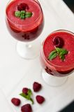 Raspberry smoothie. Still life of raspberry smoothie served in wine glasses Stock Photo