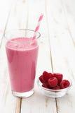 Raspberry smoothie on wood. En table Stock Photos