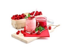Raspberry smoothies, raspberry jam and a basket with ripe raspberries on a white background. Stock Photography