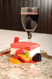 Raspberry sorbet. Served on granite with port wine royalty free stock images