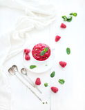 Raspberry sorbet ice-cream with mint leaves  and Royalty Free Stock Photography
