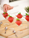 Raspberry sorbet with mint. Herb in glass stock photography