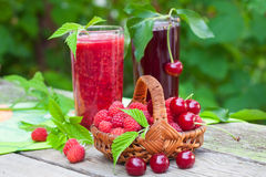 Raspberry and sour cherry juice Stock Photo