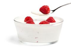 Raspberry on a spoon over a dessert in a bowl Stock Photos
