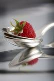 Raspberry on spoons Stock Photo