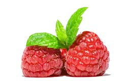 Raspberry with sprig of mint leaves on top macro close-up isolated on white Royalty Free Stock Photos