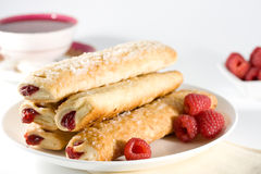Raspberry sticks pastry on white plate Stock Photo