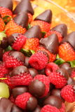 Raspberry and Strawberries with chocolate sauce Stock Photography