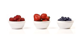 Raspberry, Strawberry and Blueberry. Three bowls with Raspberry, Strawberry and Blueberry isolated on white Royalty Free Stock Image