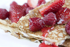 Raspberry and strawberry crepes or pancakes Stock Photo