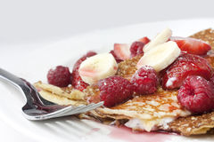 Raspberry and strawberry crepes or pancakes Royalty Free Stock Photography