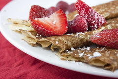 Raspberry and strawberry crepes or pancakes Stock Photos