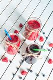 Raspberry, strawberry jam and blueberry Stock Images