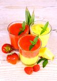 Raspberry, strawberry and pineapple smoothie mixed, deco Stock Image