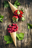Raspberry and strawberry in sugar cones. Stock Photo