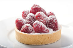 Raspberry Tart. A delicious raspberry tart dusted with icing sugar Stock Photo