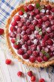 Raspberry tart with cream cheese and mint closeup. Vertical top Royalty Free Stock Images