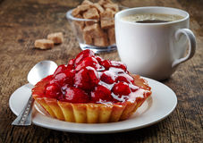 Raspberry tart and cup of coffee Stock Image