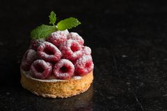 Raspberry tart dessert on dark background. Traditional french sweet pastry. Delicious, appetizing, homemade cake with Royalty Free Stock Image