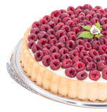 Raspberry Tart isolated on white. Raspberry Tart on a plate isolated on white background Royalty Free Stock Photography