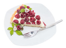 Raspberry Tart on plate against white Royalty Free Stock Photos