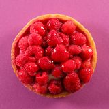 Raspberry tart. On pink background Royalty Free Stock Image