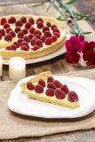 Raspberry tart on wooden table Royalty Free Stock Photo