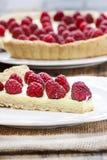 Raspberry tart on wooden table Royalty Free Stock Photo