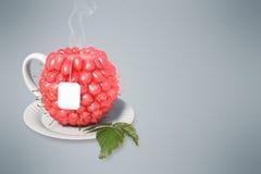 Raspberry tea cup. Healthy food. Raspberry drink Stock Photography