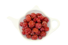 Raspberry on a teapot shaped plate isolated Stock Photos